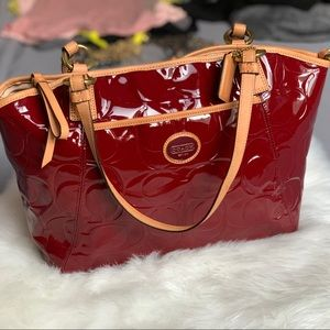 Coach crimson and tan patent leather tote.